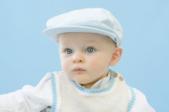 Serious Baby. Boy dressed up in golfer hat and vest Stock Images