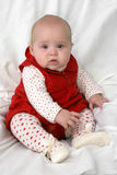 Serious baby. Serious beautiful baby girl in fashion - red heart Royalty Free Stock Image