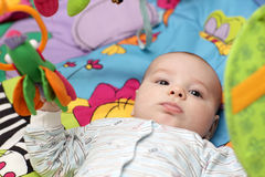 Serious baby boy Stock Photography