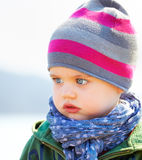 Serious baby boy. Portrait of sad and serious little baby boy in springtime Stock Image