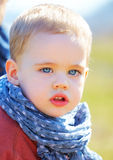 Serious baby boy. Portrait of sad and serious little baby boy in springtime Stock Photography