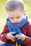 Serious baby boy. Portrait of sad and serious little baby boy in springtime Royalty Free Stock Images