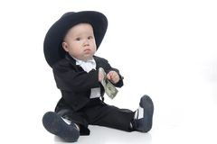 Serious Baby Boy In Hat With Us Dollar Stock Photography