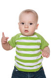 Serious baby boy shows his finger up Royalty Free Stock Photo