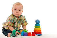 Serious baby boy with toys Stock Photo