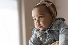 Serious baby girl Stock Image