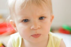 Serious baby girl face Stock Image