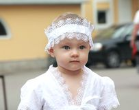 Serious baby girl in white hat Stock Image