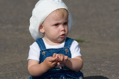Serious baby sitting Royalty Free Stock Photos