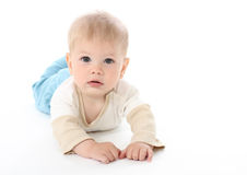 Serious Baby on White. Background, isolated, tummy time Royalty Free Stock Photography