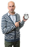 Serious bald guy with an alarm clock Royalty Free Stock Images