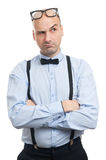 Serious bald guy with suspenders and bow-tie thinking Royalty Free Stock Photos