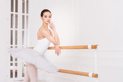 Serious ballerina posing in ballet class Royalty Free Stock Images