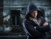 Serious bandit in ghetto Stock Photography