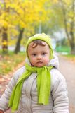 Serious bay in hat and scarf royalty free stock photography