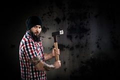Serious bearded lumberjack holding an axe Royalty Free Stock Photography