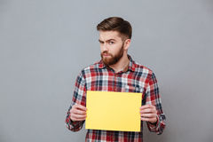 Serious bearded man holding copyspace blank Royalty Free Stock Photo