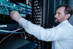 Serious bearded man looking at the internet wires Royalty Free Stock Image