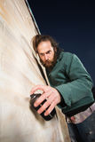 Serious Bearded Man Spray Painting Stock Images