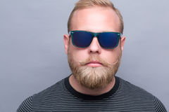 Serious bearded man in sunglasses Royalty Free Stock Images