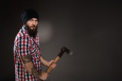 Serious bearded woodcutter holding an axe Stock Image