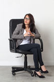 Serious beautiful businesswoman sitting for her startup job Royalty Free Stock Photo