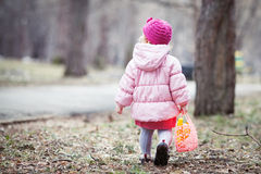 Serious beautiful girl walking with handbag in spring park Stock Photography