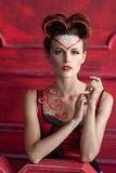 Serious beautiful woman with hearts decorations Royalty Free Stock Photography