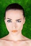 Serious beautiful woman raising an eyebrow stock images