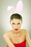Serious and beautiful woman wearing bunny ears Stock Photography