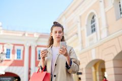 Young woman checking sms royalty free stock photography