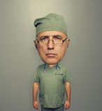 Serious bighead doctor in glasses. And uniform over grey background stock illustration