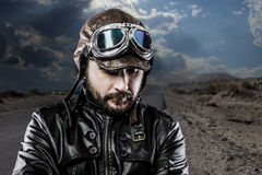 Serious biker with black leather jacket Stock Photo