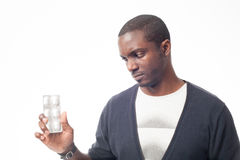 Serious black man with pack of pills. Isolated on white royalty free stock images