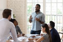 Free Serious Black Manager Talk To Diverse Staff People At Meeting Stock Photography - 156764842