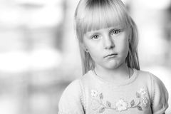 Serious blond little girl looking sadly Royalty Free Stock Images