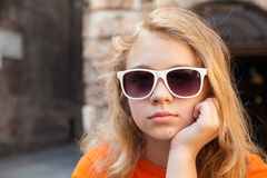 Serious blond teenage girl in sunglasses Royalty Free Stock Images