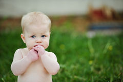 Serious Blonde Baby Boy. Serious blonde haired baby boy 8 months old Stock Image