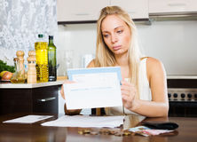 Serious blonde girl with money and documents Stock Images