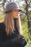 Serious blonde in hat Royalty Free Stock Photo
