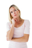 Serious blonde thinking with hand on chin Stock Images