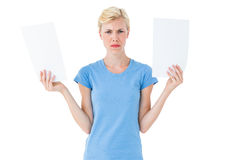 Serious blonde woman presenting paper with her hands Stock Image