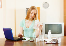Serious blonde woman reading about medications Stock Photos