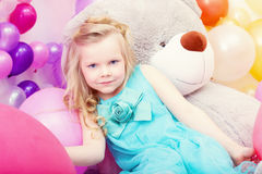 Serious blue-eyed little girl posing at camera Royalty Free Stock Image