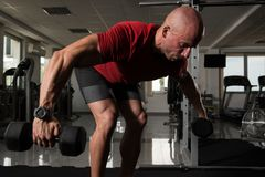 Muscular Man Doing Heavy Weight Exercise For Back royalty free stock images