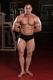 Serious Bodybuilder Standing In The Gym Stock Images