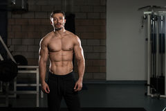 Serious Bodybuilder Standing In The Gym Royalty Free Stock Photo