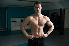 Serious Bodybuilder Standing In The Gym royalty free stock images