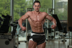 Serious BodyBuilder Standing In The Gym Royalty Free Stock Photography