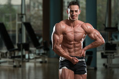 Serious BodyBuilder Standing In The Gym Stock Photos